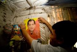 "Pema points out a displayed photo of the Bhutanese King, Jigme Singye Wangchuck, displayed in his parents' hut. ""It doesn't make sense they still respect him, they say he is bad leader but a good man"" he explains. Eighteen years ago Pema and 105,000 other Bhutanese Lhosampa peolpe were displaced when the King forced their exodus."