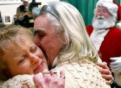 "Shirley Hawkins embraces her new husband, Robert Weber, after a wedding ceremony officiated by Santa, William Wagner, at the Harley Davidson outlet in Concord, Saturday. Hawkins had brought her son to see Santa three weeks prior and was put aback when Santa asked her Christmas wish. ""I'd like to marry that man over there,"" she said pointing at Weber, to which Wagner offered his services as a justice of the peace."