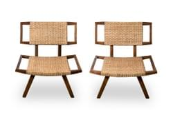 Pair of slipper chairs in the style of Paul Laszlo