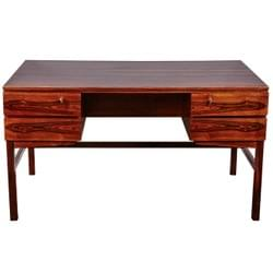 A rosewood desk by Kai Kristianson.