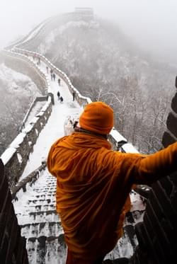Lao Monk at the Great Wall, China.