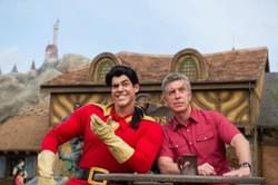 John appearing with Tom Bergeron at the opening of Fantasyland.