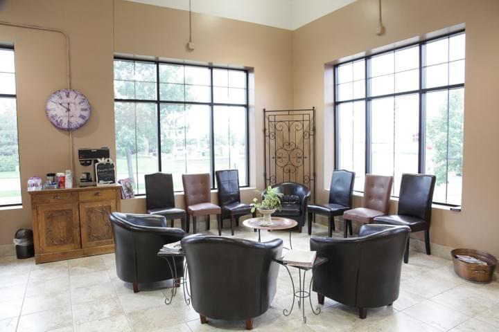 Waiting area with nice big windows and comfy chairs (+ free coffee) at Tranquility Spa Salon in Brooklyn Park, MN
