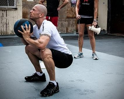 Guy lifting a medicine ball