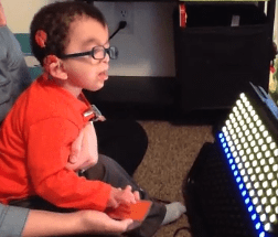 Deafblind toddler looking at liteaide.