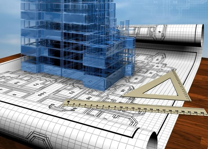 Architectural drawings on a table, rolled out with a ruler across them, and a 3D frame of a large building projecting out of the drawings