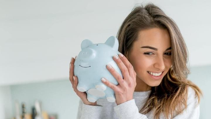 Young beautiful female student smiling about savings for tuition