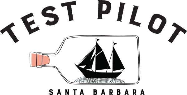test pilot logo showing a ship in a bottle and the name of bar
