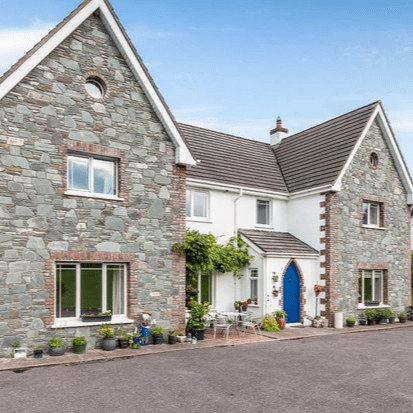 Property Description Colbert & Co Estate agents are delighted to present this wonderful home to the open market. Feargalss House is a spacious 2,800 sq/ft property set upon just under one acre of secluded land. Your grounds are delicately landscaped with gated entrance to ensure privacy. Lisgoold is short 10-minute commute from Midleton town but also has easy access to surrounding areas such as Glanmire, Carrigtwohill and Little Island. The village itself is only a 2-minute walk away and hosts a shop, pub and church. It is a quiet and beautiful area, perfect for forest walks and those who love the country life yet close enough to modern living.  Inside the home, you have ample space all well laid out to serve everyone's needs in the family as well as the option to have a self-contained granny flat on the ground floor. The entrance hall has a welcoming feel with marble tiled floor, lofted ceiling and carpeted stairs that stretch to the 1st floor. You have 5 bedrooms and further 6th bedroom on the ground floor, this is currently used as pantry off the kitchen area. There are 2 living spaces with the main living room hosting a fitted stove with a beautiful antique French stone fireplace. On the first floor you have freshly laid carpet throughout the landing and bedrooms. In total, there are 2 full bathrooms along with 3 ensuite toilets so no more bickering over spending too much time in the toilet for those larger families!  This property has a unique warm feeling to it, one that only comes from a family occupied property. We would strongly suggest you contact us now for a viewing to avoid disappointment on 021 4639557