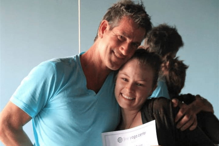 2015 Yoga Teacher training photo with larry Thraen and student.