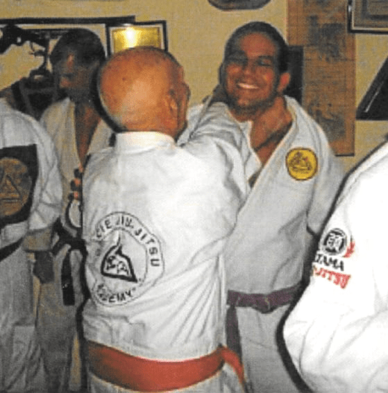 Paulo assisting GM. Helio Gracie  in a group class at his home dojo