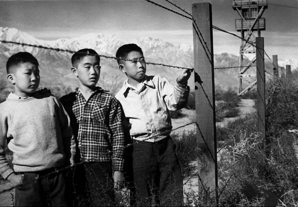 Three boys at Manzanar internment camp in 1943. Photo by Toyo Miyatake