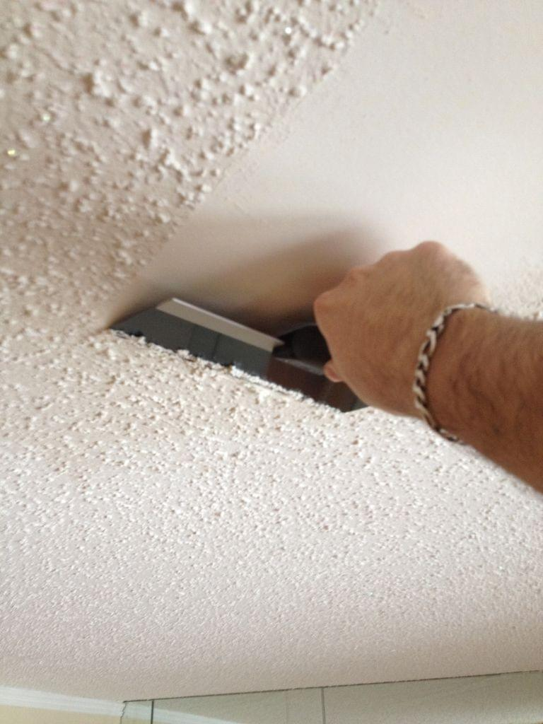 Worker Scraping Popcorn Ceilings