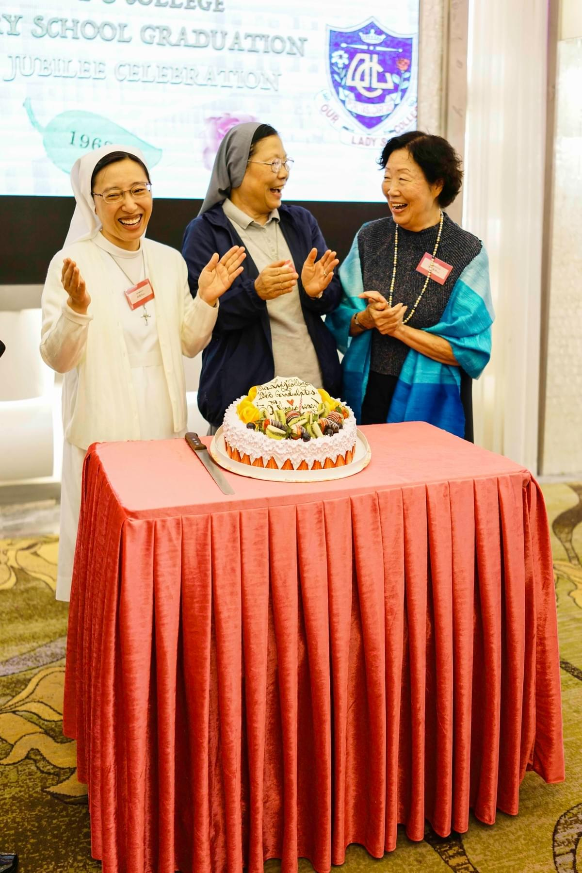 The Cake Cutting Ceremony at dinner hosted by Supervisor, Sr Tso, Principal Sr Lim and Former Principal Mrs Li of OLC