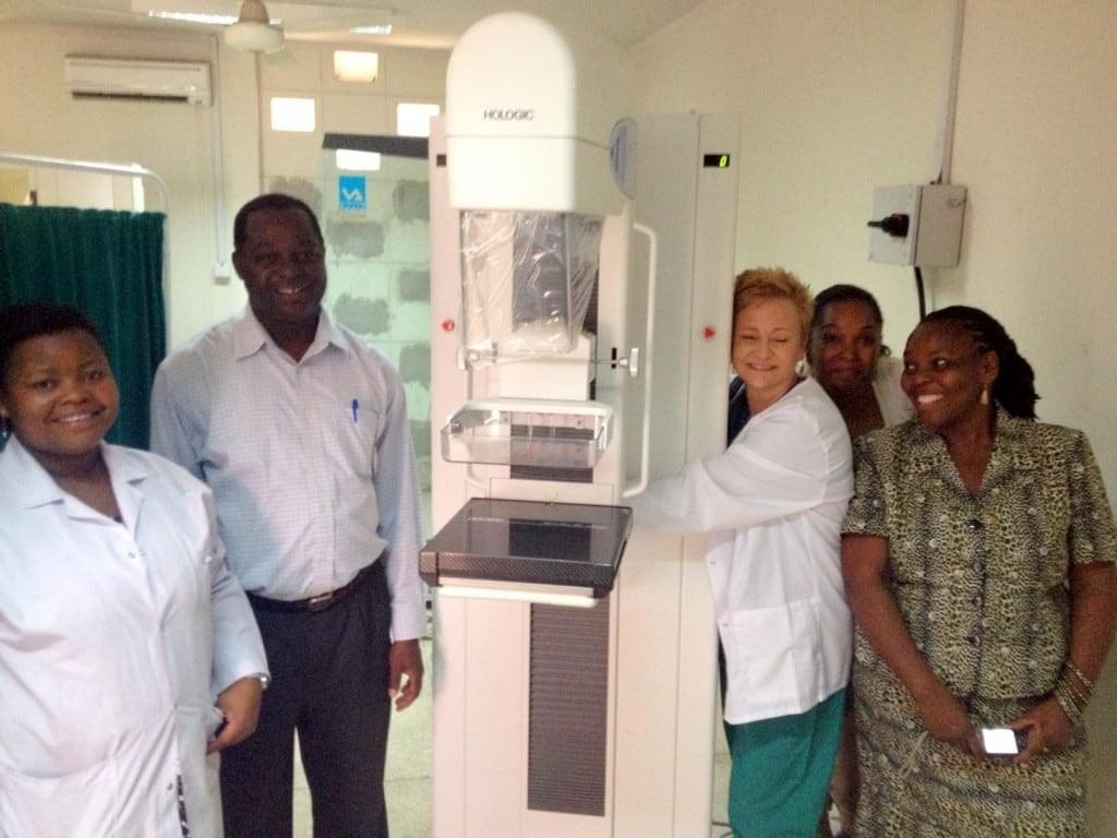 Laurie Ziegler, Women's Health Coordinator, pictured with Hologic Mammo and Muhimbili staff