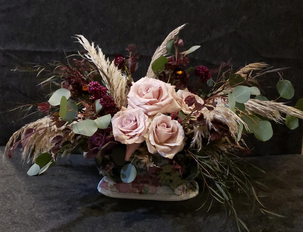 Fall Floral Centerpiece in Autumn Colors Using Berries and Pampas Grass