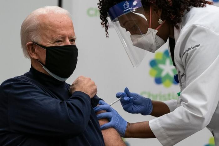 US President-elect Joe Biden receives a Covid-19 vaccination from Tabe Mase, Nurse Practitioner and Head of Employee Health Services, at the Christiana Care campus in Newark, Delaware on December 21, 2020. (Photo by ALEX EDELMAN / AFP)  AFP VIA GETTY IMAGES