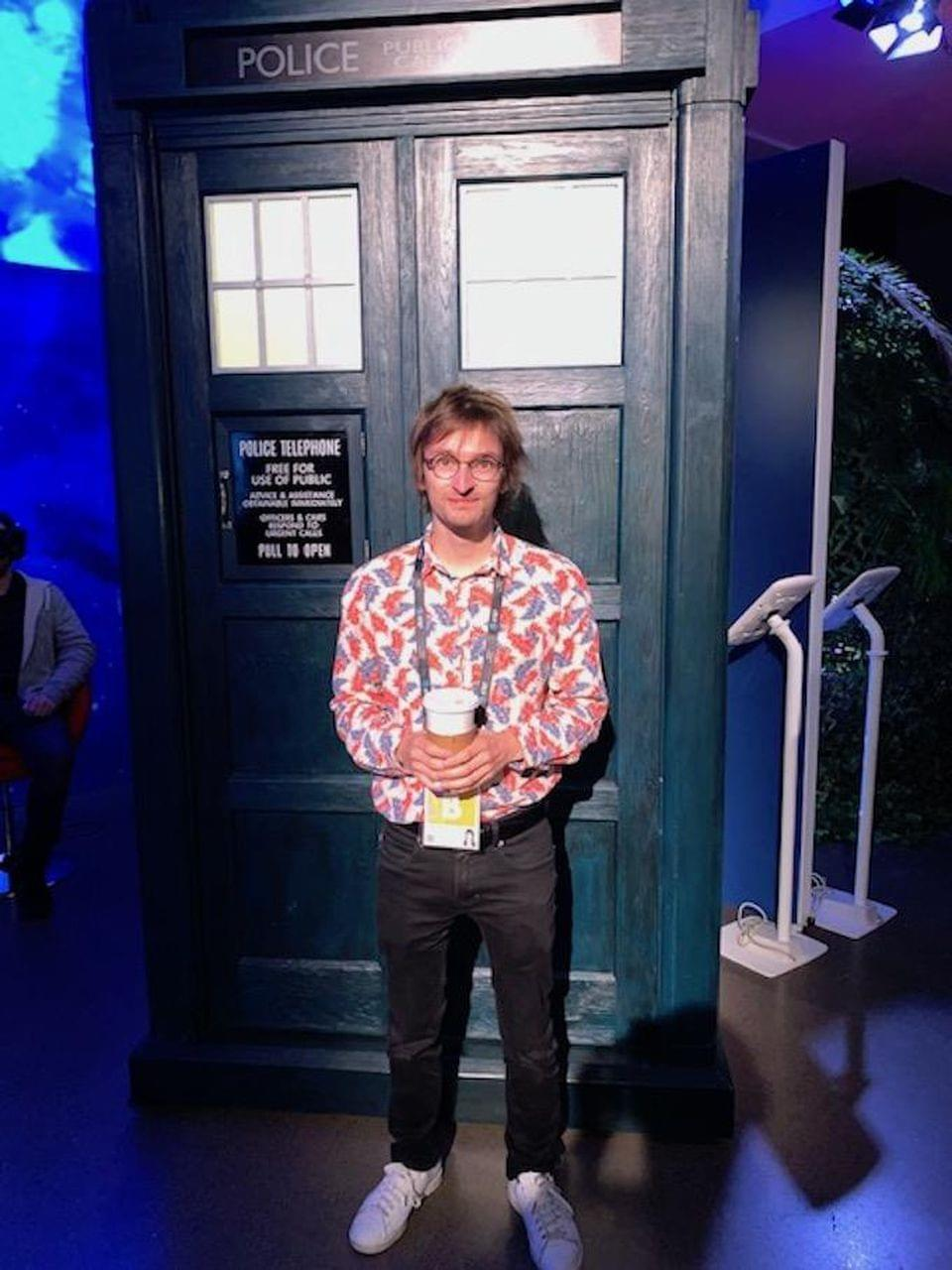 "Director Mattias Chelebourg with the iconic telephone booth from ""Dr. Who."" CHARLIE FINK"