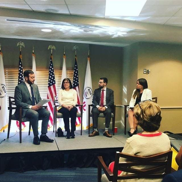 Adam Weissmann (center) speaks on a panel at USAID on genocide prevention on May 2nd about the long lasting impacts of genocide on subsequent generations.