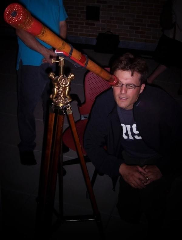 The author looking through a working replica of one of Galileo's telescopes