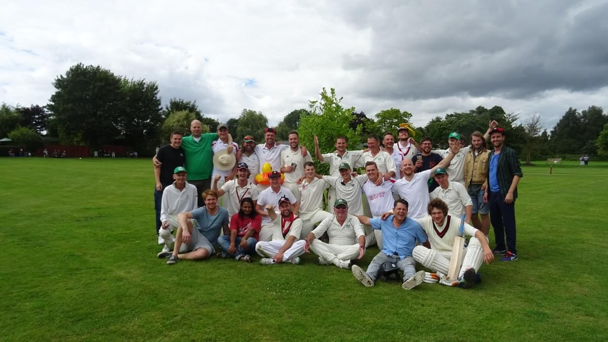 Team picture at Moreton Cricket Club in front of Lola the Magnolia (aka Amsterdam Tree)