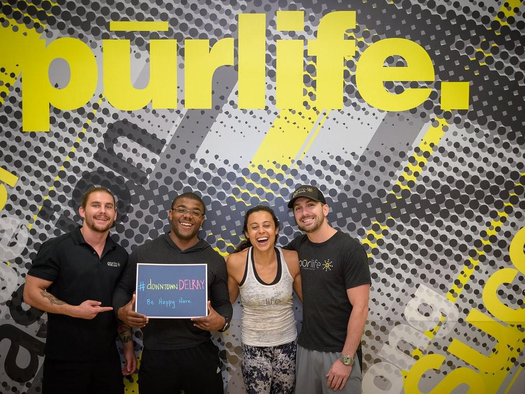 Photo of smiling team members from Purlife in downtown Delray Beach.