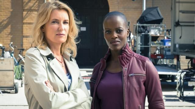 Photo credit: NDR/obs (Kasumba and Furtwängler on the set of Tatort-Göttingen)