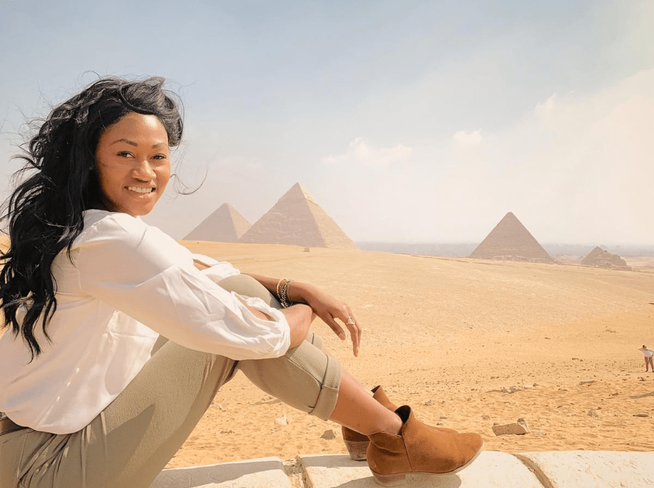 Brit Thompson in front of the historic and massive Great Pyramids of Egypt in Cairo.