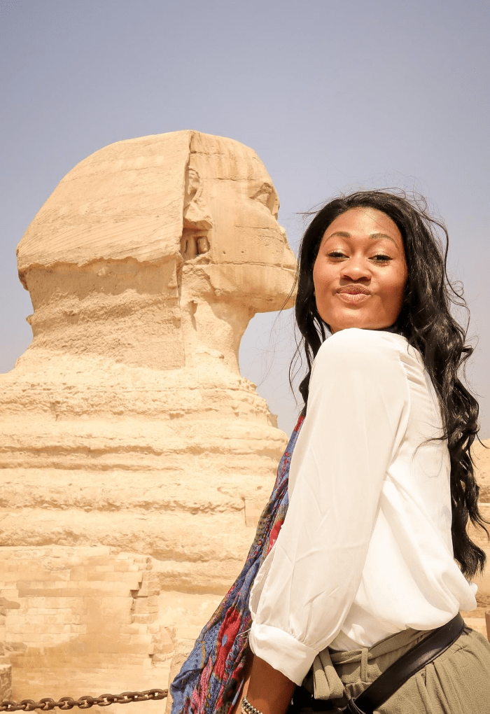 Brit Thompson getting a kiss from the Great Sphinx of Giza in Cairo Egypt