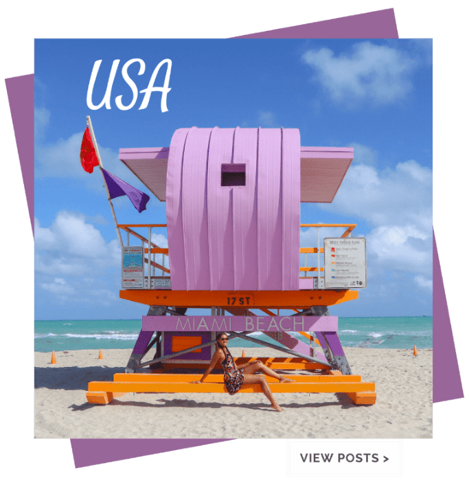 girl sitting on purple lifeguard stand in miami beach florida