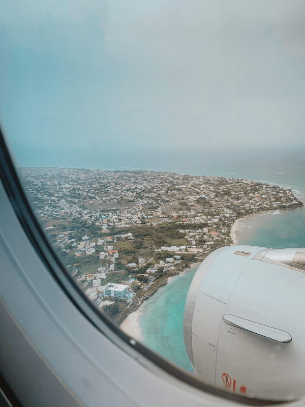 Aerial view of Barbados island from a landing airplane with the ocean and land