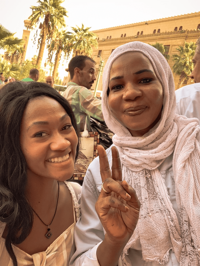 Brit Thompson with Nubian women in Khan el-Khalili bazaar in Cairo Egypt
