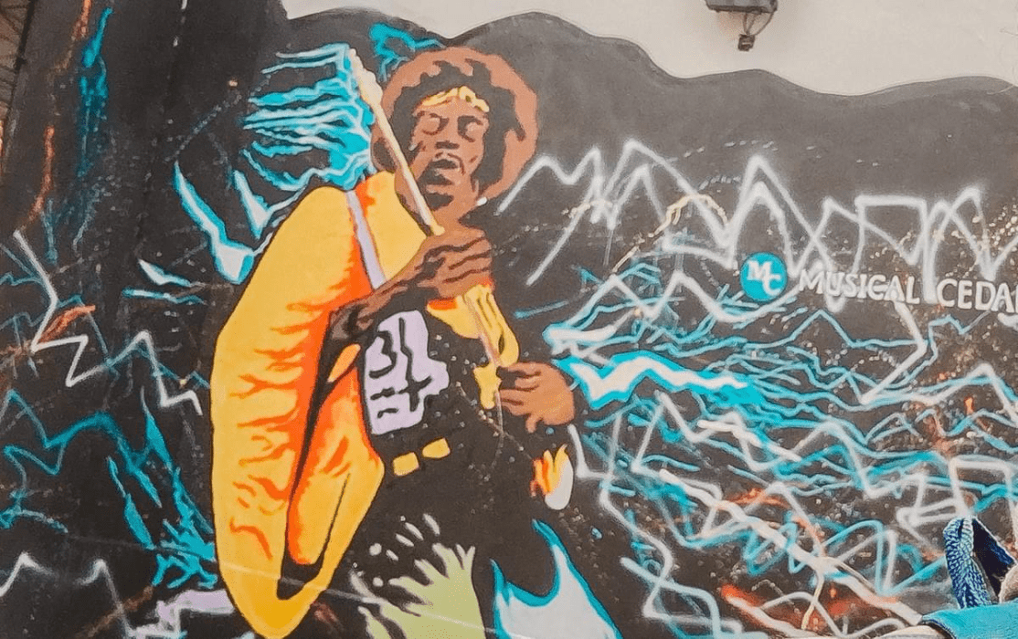 street art of jimi hendrix playing the guitar