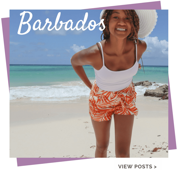Smiling Black girl with sun hat on beach in Barbados