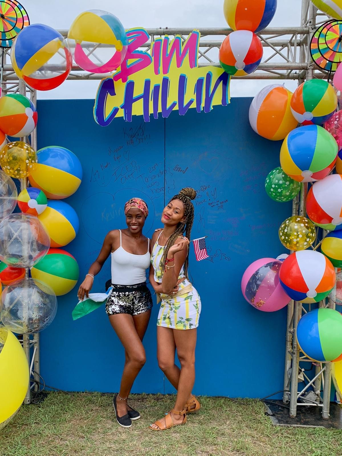Two girls posing at the BIM Chillin Cooler fete in Barbados for Crop Over