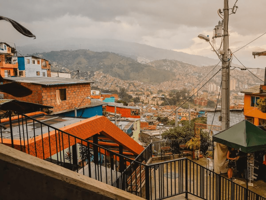 escalators in comuna 13 colombia and a view of the green mountains