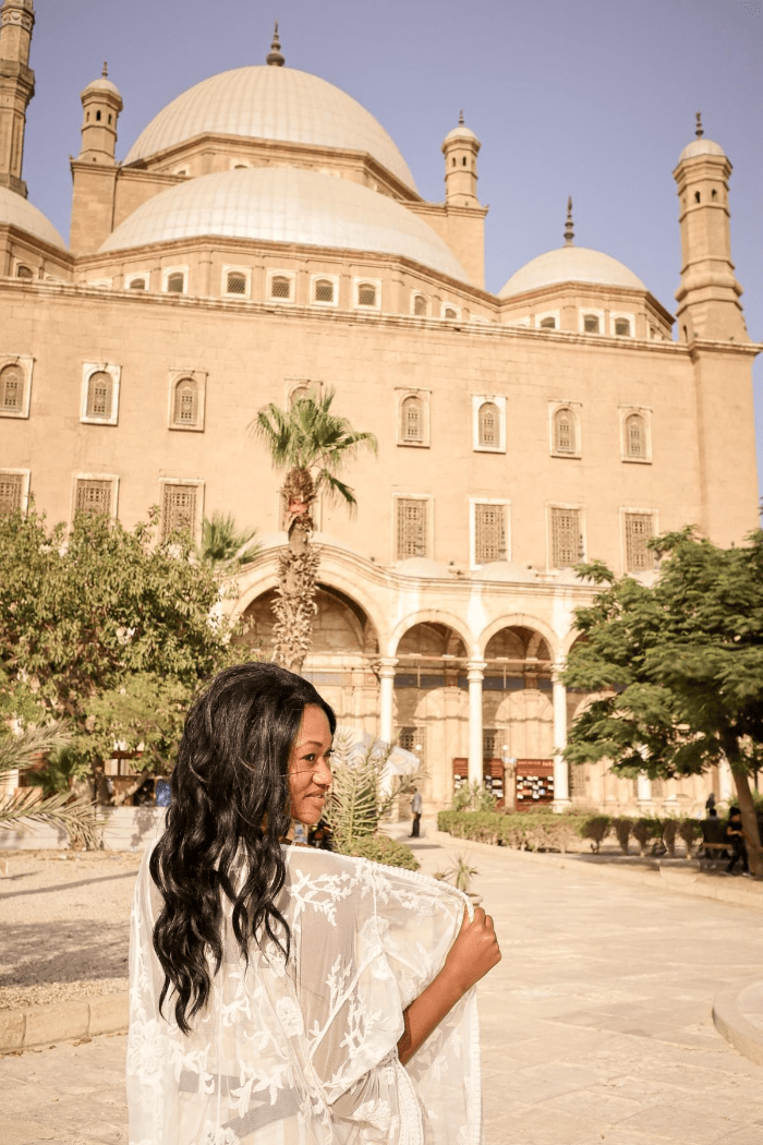 Brit Thompson in front of the Mosque of Muhammad Ali in Cairo Egypt