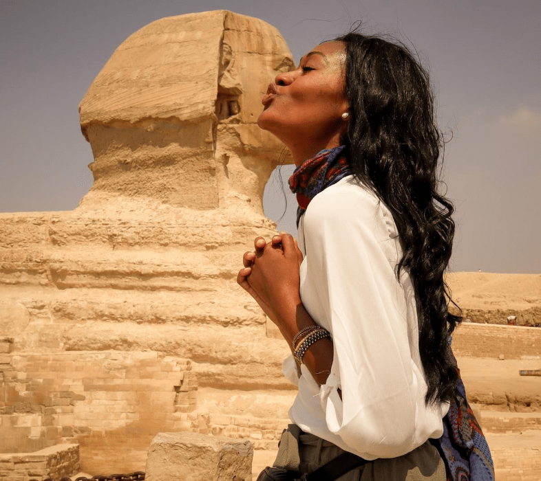 Brit Thompson cheek kissing the Sphinx in Cairo Egypt