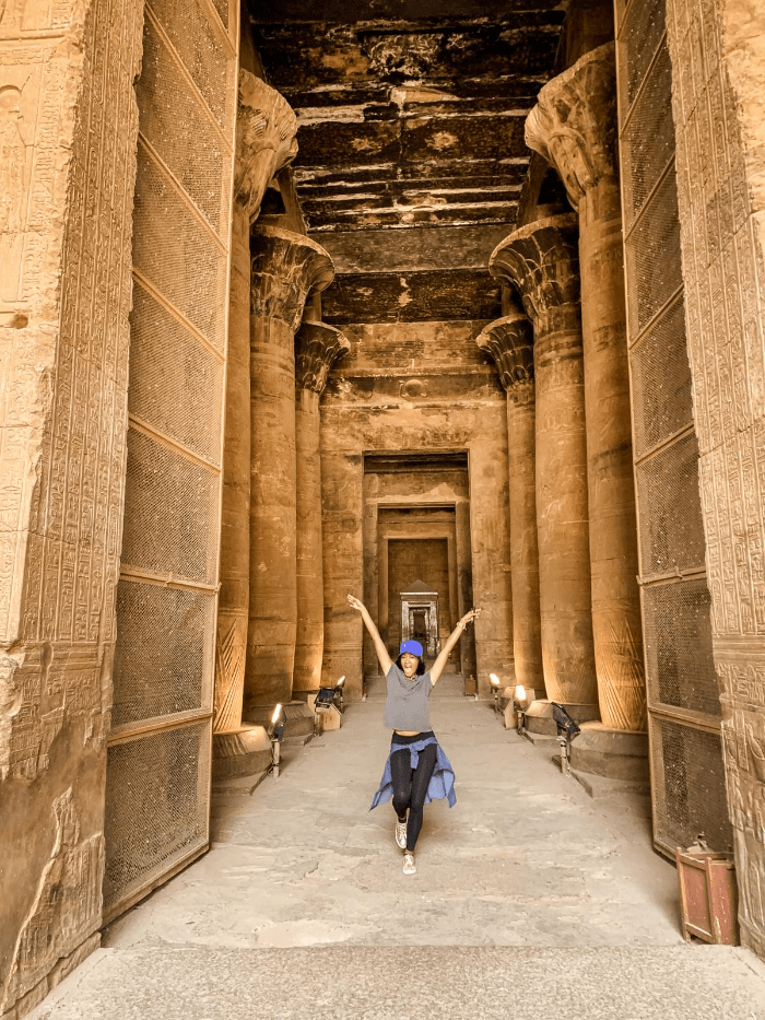 Brit Thompson celebrating history in the chamber of Edfu Temple of Horus in Aswan, Egypt