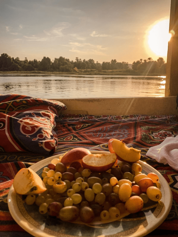 Fruit plate on a traditional felucca sailing at sunset to Aswan, Egypt on the Nile River