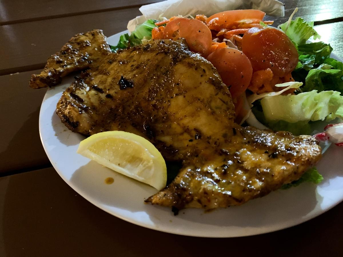 A grilled Marlin fish plate with salad from Just Grillin' in Holetown, Barbados