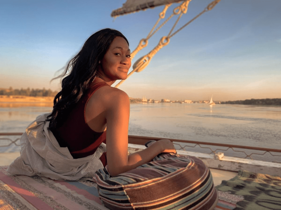 Brit Thompson on a traditional felucca sailing the Nile River in Egypt at sunset