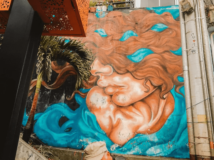 Street art woman with baby and brown wavy hair at comuna 13 Commune 13 San Javier