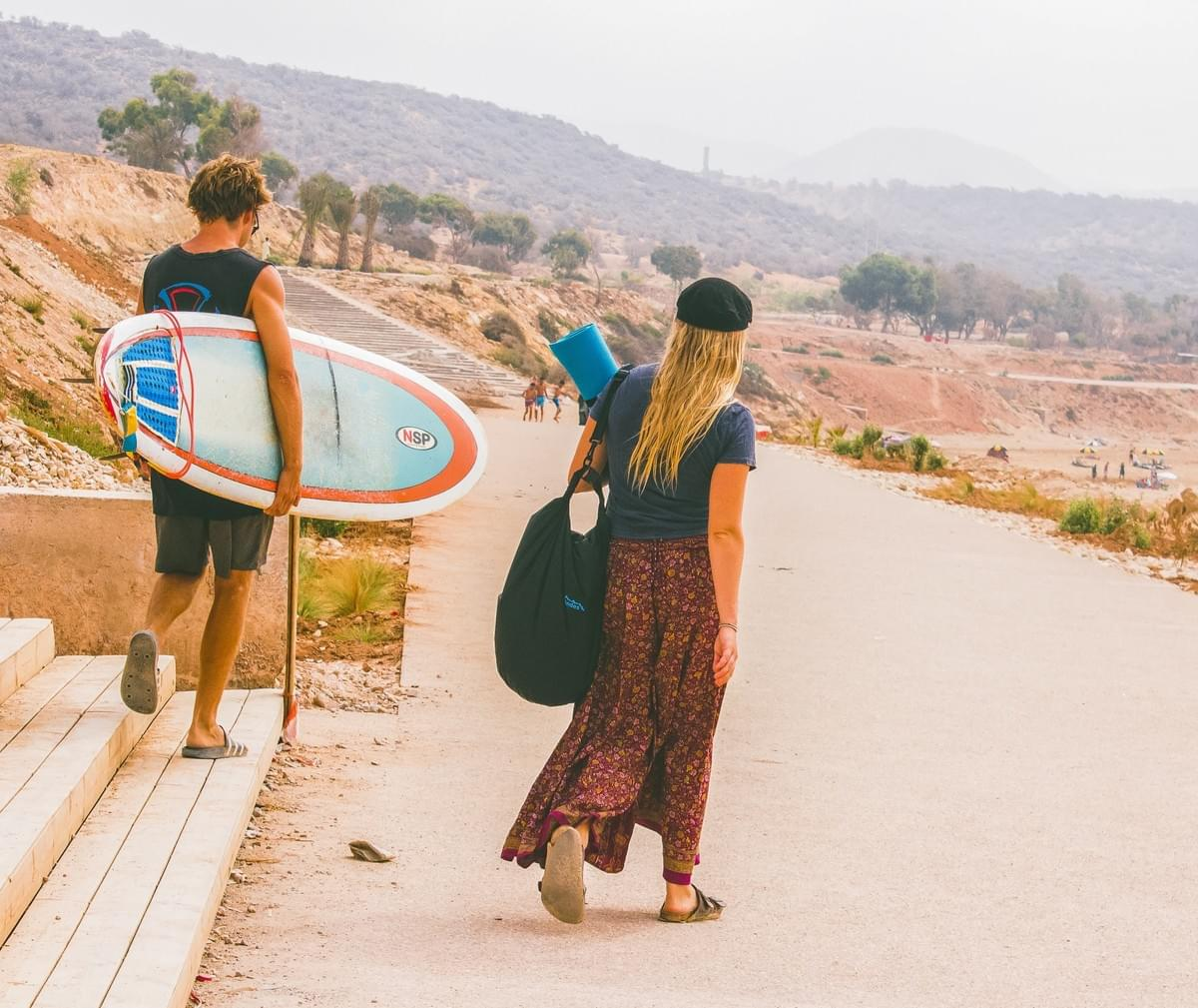 man, woman, surfboard, surf, bag, yoga mat, road, morocco, things to do