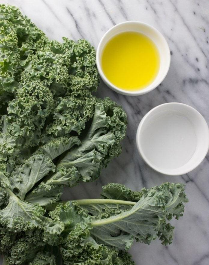Kale, oil, vinegar, and salt are the only ingredients needed for a delicious, healthy snack