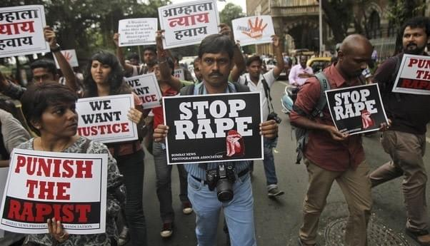 https://qzprod.files.wordpress.com/2014/09/india-rape.jpg?quality=80&strip=all&w=1588