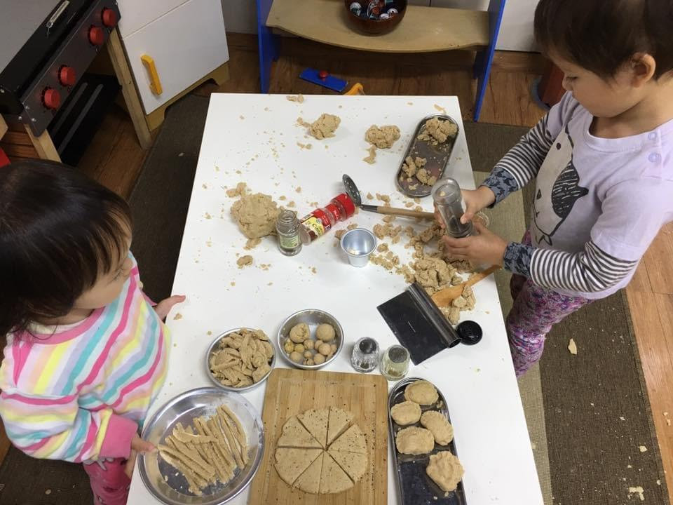 Busy little chefs in our play kitchen making imaginary pizza, noodles, cookies and more, using real seasoning and spices too