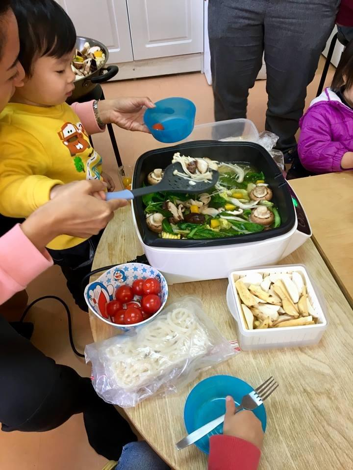 Chinese hot pot style cooking veggies on a cold winter's day at Mulberry Tree School, Tai Po, Hong Kong