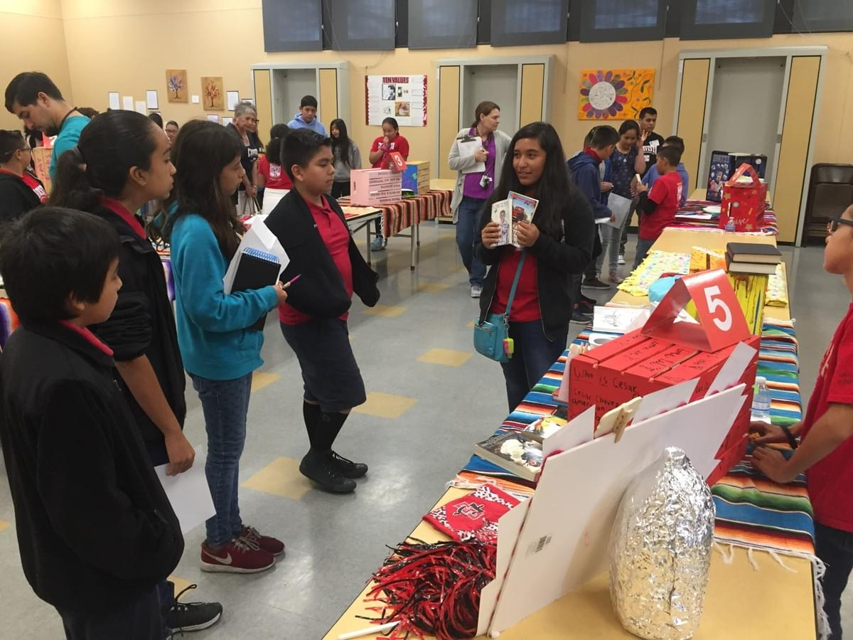 Students show off their reading presentations at school fair