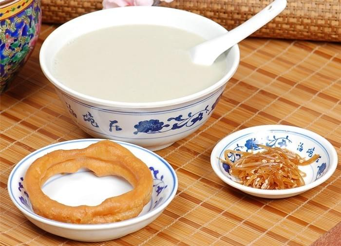 Mung Bean Milk 豆汁 Douzhi is a traditional breakfast in Beijing typically eaten with fried dough 油条 you tiao.